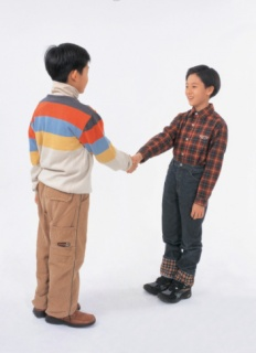 Two boys shaking hands
