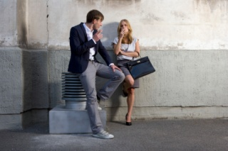 Young Businesspeople Smoking Cigarettes