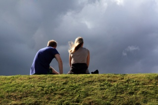 couple under storm clouds