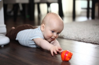 baby crawling to toy