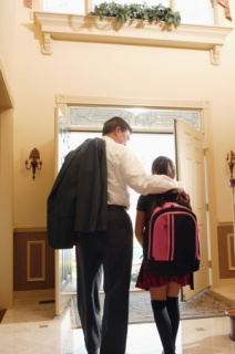 Father and daughter leaving house together