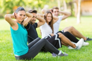 Group of people exercising in a park
