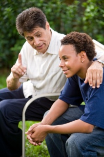 Man giving advice to teen boy
