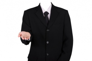 man in business suit holding out hand
