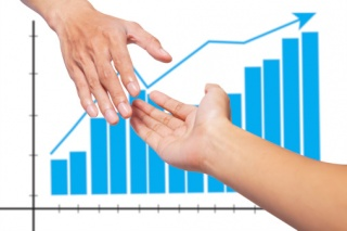 Shaking hands in front of graph