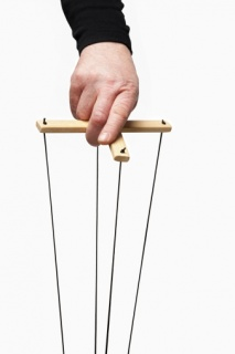 hand holding marionette control bar