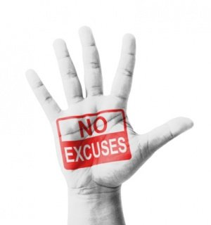 Open hand raised, No Excuses sign painted