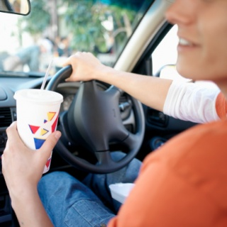 Young Man In Car Holding A Beverage Cup